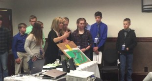 Middle School students analyzing community issues with GIS